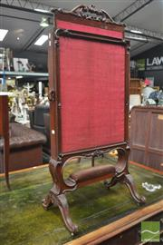 Sale 8317 - Lot 1061 - Good Early Victorian Carved Mahogany Firescreen with pull-out red fabric panels & velvet upholstered stretcher on carved cabriole legs