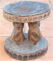 Sale 8550H - Lot 19 - A Papua New Guinean four legged carved timber organic stool from the Blackwater region, H 31cm