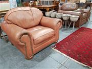 Sale 8889 - Lot 1077 - Pair of Brown Leather Armchairs