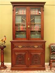 Sale 8925H - Lot 29 - An antique carved mahogany secretaire bookcase with fitted desk over base cupboard (marriage), Height 235cm, Width 122cm, Depth 51cm