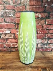 Sale 8500A - Lot 86 - A retro style glazed ceramic tall green vase featuring lovely leaf motif - Condition: Very Good - Measurements: 43cm high