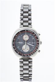 Sale 8293 - Lot 348 - A VINTAGE SEIKO CHRONOGRAPH UFO  AUTOMATIC CALENDAR WRISTWATCH; ref; 6138-0011 black dial with short hands, centre seconds, 2 subs...