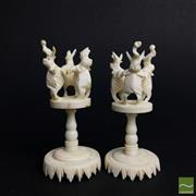 Sale 8540N - Lot 44 - A Selection of Chinese Figural Ivory , as modelled as puzzle ball holders , with elephant supports (2) AF