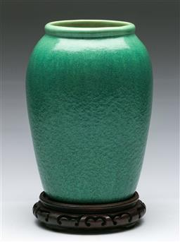 Sale 9156 - Lot 4 - A Melrose Ware green glaze vase on Chinese timber stand (H:29cm)