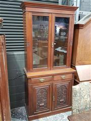 Sale 8774 - Lot 1022 - Late Victorian Walnut Bookcase, with two glass panel doors, above two drawers & two carved panel doors (key in office together with...