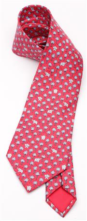 Sale 9080F - Lot 60 - AN HERMES SILK TIE IN BOX; red with blue elephants and palm trees.