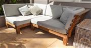 Sale 8741A - Lot 1 - An outdoor teak sofa and cushions, each section 135cm x 90cm