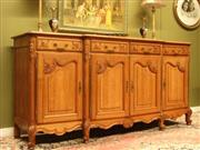 Sale 8925H - Lot 34 - A vintage French oak breakfront four door sideboard with parquetry detail to the top and side panels, Height 108cm, Width 225cm, Dep...