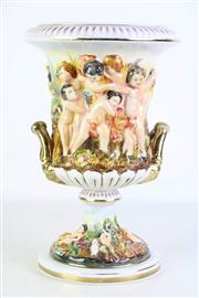 Sale 8913C - Lot 42 - An Elaborate Capodimonte Urn Form Vase Featuring Children in Garden (H 33.5cm)