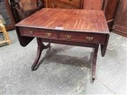 Sale 9031 - Lot 1032 - Good Regency Style Mahogany Sofa Table, with two frieze drawers, on end supports with outswept feet (missing handles on other side)