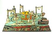Sale 8330T - Lot 51 - German Tinplate Clockwork Shell Traffic Table and Miniature Train; 1920s with signalling Policeman, missing main vehicle. Train wit...