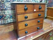 Sale 8634 - Lot 1003 - Late 19th Century Cedar Apprentice Chest of Five Drawers, with black ceramic knobs
