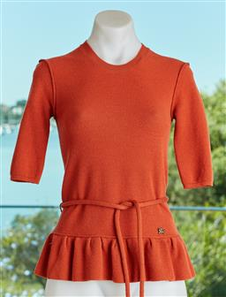 Sale 9120K - Lot 7 - A Burberry London burnt orange 3/4 sleeve sweater top, with ruffled waist line and a prorsum logo pin together with a waist tie. Size S
