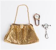 Sale 8685F - Lot 28 - A Whiting & Davis Co. gold-toned mesh purse, H 12 x W 19cm, together two Xanadu ornamental clip pocket clocks