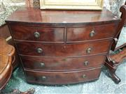 Sale 8831 - Lot 1009 - Early Victorian Flame Mahogany Bow Front Chest of 5 Drawers
