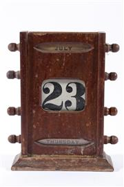 Sale 9007 - Lot 37 - Early 20th century timber calendar (H19cm, some losses and missing top)
