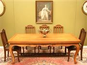 Sale 8925H - Lot 37 - A vintage French walnut draw leaf dining table. Extends to 3 metres, seating twelve, Height 74cm, Width 200 to 300cm, Depth 90cm