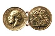 Sale 8426 - Lot 334 - A GOLD HALF SOVEREIGN BROOCH; composed of two 1915 Sydney mint half sovereigns, wt. 8.7g.