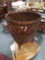 Sale 8676 - Lot 1374 - Weaved Basket Raised on Timber Feet