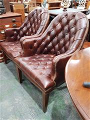 Sale 8714 - Lot 1063 - Pair of Brown Buttoned Leather Armchairs, with studded trim