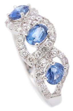 Sale 9246J - Lot 334 - AN 18CT WHITE GOLD SAPPHIRE AND DIAMOND CLUSTER RING; composed of 3 open contoured clusters each centring an oval cut blue sapphire...