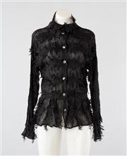 Sale 8740F - Lot 54 - A Yoshiki Kishinuma black crimped blouse with rows of lasercut feathered/dagged trim, size JP 3