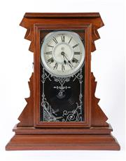 Sale 9007 - Lot 13 - Waterbury gingerbread timber mantle clock, circa 1890 (H46cm) with pendulum