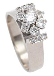 Sale 8937 - Lot 399 - A 9CT WHITE GOLD DIAMOND CLUSTER RING; high claw set with 7 early round brilliant cut diamonds totalling approx. 0.60ct ( 2 chipped)...