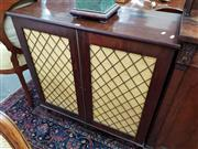 Sale 8728 - Lot 1043 - Regency Mahogany and Brass Grill Chiffonier, the two doors with fabric backed panels