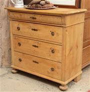 Sale 9060H - Lot 87 - A continental pine chest of four drawers on bun feet. Height 93 x width 94 depth 47cm