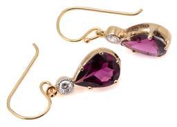 Sale 9149 - Lot 399 - A PAIR OF 9CT GOLD GARNET AND DIAMOND EARRINGS; each an approx. 1.60ct pear cut rhodolite garnet surmounted by a round brilliant cut...