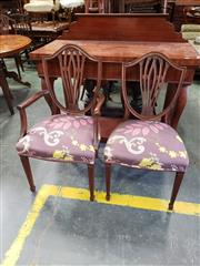 Sale 9031 - Lot 1055 - Set of Four Hepplewhite Style Mahogany Chairs, incl. two armchairs, the shield backs with pierced splats, purple foliate upholstery...