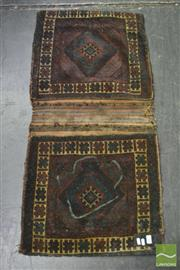 Sale 8335 - Lot 1035 - Probably East Persian Wool Saddle Bag, with hooked gul motif (slight faults 121 x 58cm)