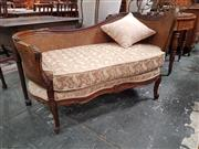 Sale 8868 - Lot 1039 - Louis XV Style Carved Walnut Chaise or Daybed, with caned back and yellow upholstered seat, on cabriole legs
