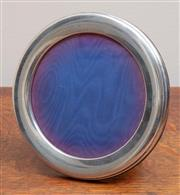 Sale 9071H - Lot 34 - A Sterling silver circular photo frame by Broadway & Co marked Birmingham 1988, Diameter 14cm
