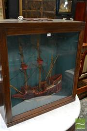 Sale 8460 - Lot 1039 - Model of a Galleon, in an oak case with sliding door & fitted light