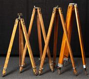 Sale 8984W - Lot 529 - A pair of Government issue surveyors tripods, unextended height approx 104cm together with two other examples.
