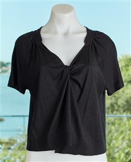 Sale 9120K - Lot 59 - A Saba silk and cotton short sleeve cardigan in black, with pleated shoulder line. Size 10 (minor stain)