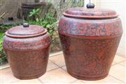 Sale 8550H - Lot 17 - A pair of graduated lacquered storage containers with red and black floral decoration, Largest H 70cm