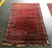 Sale 8868 - Lot 1120 - Princess Bokhara Wool Carpet, with typical panels in russet tones (195 x 125cm)