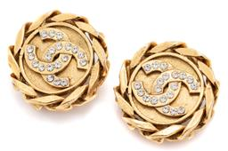Sale 9115 - Lot 325 - A PAIR OF CHANEL STONE SET CLIP EARRINGS; 30mm round gold tone earrings centring crossed Cs set with round cut white stones to chai...