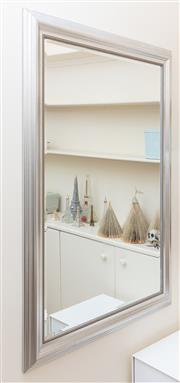Sale 8866H - Lot 78 - A Bevelled edge mirror with a silvered frame, Height 130cm, Width 94cm