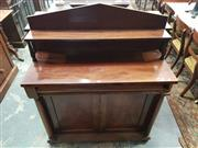 Sale 8917 - Lot 1069 - Regency Mahogany Chiffonier, with tympanum back and shelf, above a long drawer & two panel doors, flanked by columns