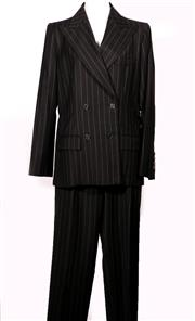 Sale 9029F - Lot 32 - AN YVES SAINT LAURENT PIN STRIPE BLACK WOOLEN SUITE; double breasted jacket with flap pockets, zip fronted wide legged trousers with...