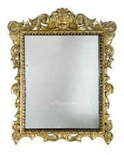 Sale 8651A - Lot 95 - A late 18th Century Italian baroque style carved gilt wood framed mirror, 80 x 62 cm