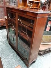 Sale 8714 - Lot 1025 - Georgian Style Mahogany Low Bookcase, with two astragal doors and bracket feet