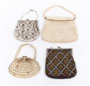 Sale 8800F - Lot 97 - Four purses, to include three beaded examples and another