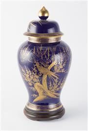 Sale 8518A - Lot 26 - A large cobalt blue lidded vase, gilt decoration of an exotic bird amidst cherry blossom, on turned timber base. Ht: 44cm