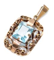 Sale 9037 - Lot 351 - A VINTAGE 14CT GOLD STONE SET PENDANT; set with a synthetic blue spinel within a scroll work frame, size 38.5 x 20.56mm, wt. 4.92g.