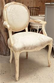 Sale 9060H - Lot 94 - A French bergère with carved timber frame and ivory painted finish upholstered in cream silk brocade and piping. Height 99cm